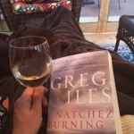 Snuggled up with a glass of Sauvignon Blanc and a good book